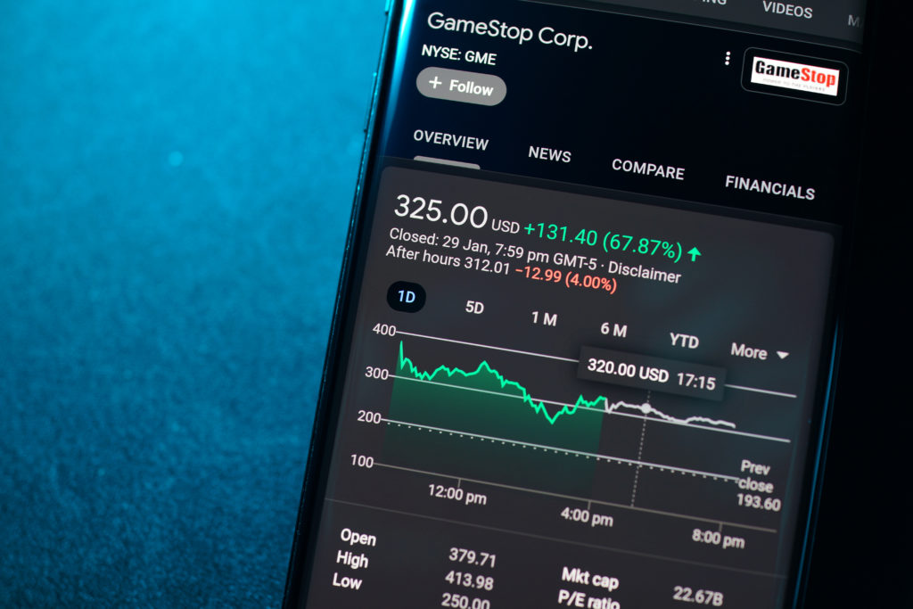 GameStop Corp stock index is seen on a smartphone. Trading in GameStop impacts Wall Street hedge funds. PENANG, MALAYSIA - 31 JAN 2021.